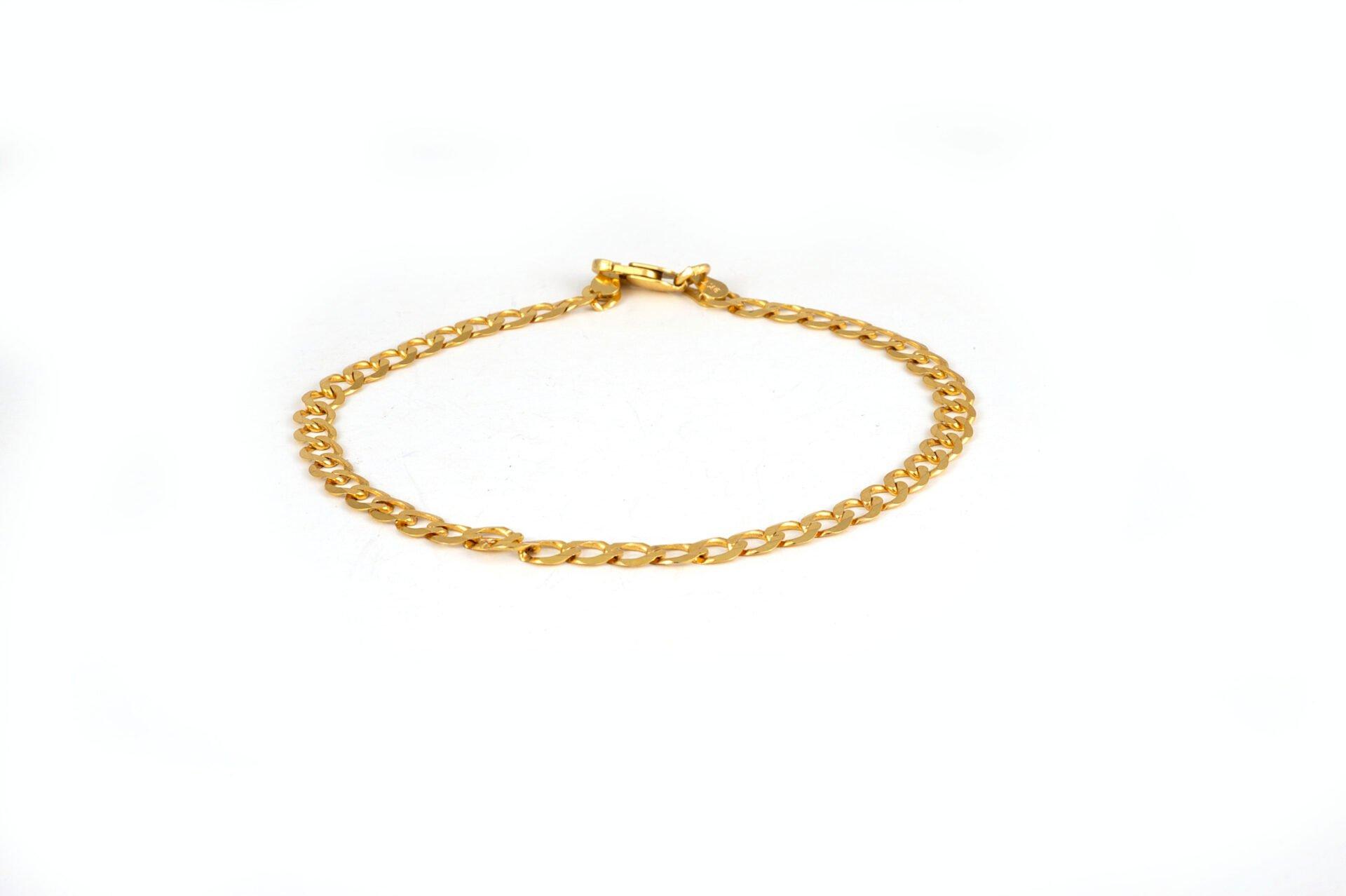 Eternity Jewellery owner, Nico, evaluates piece of jewellery