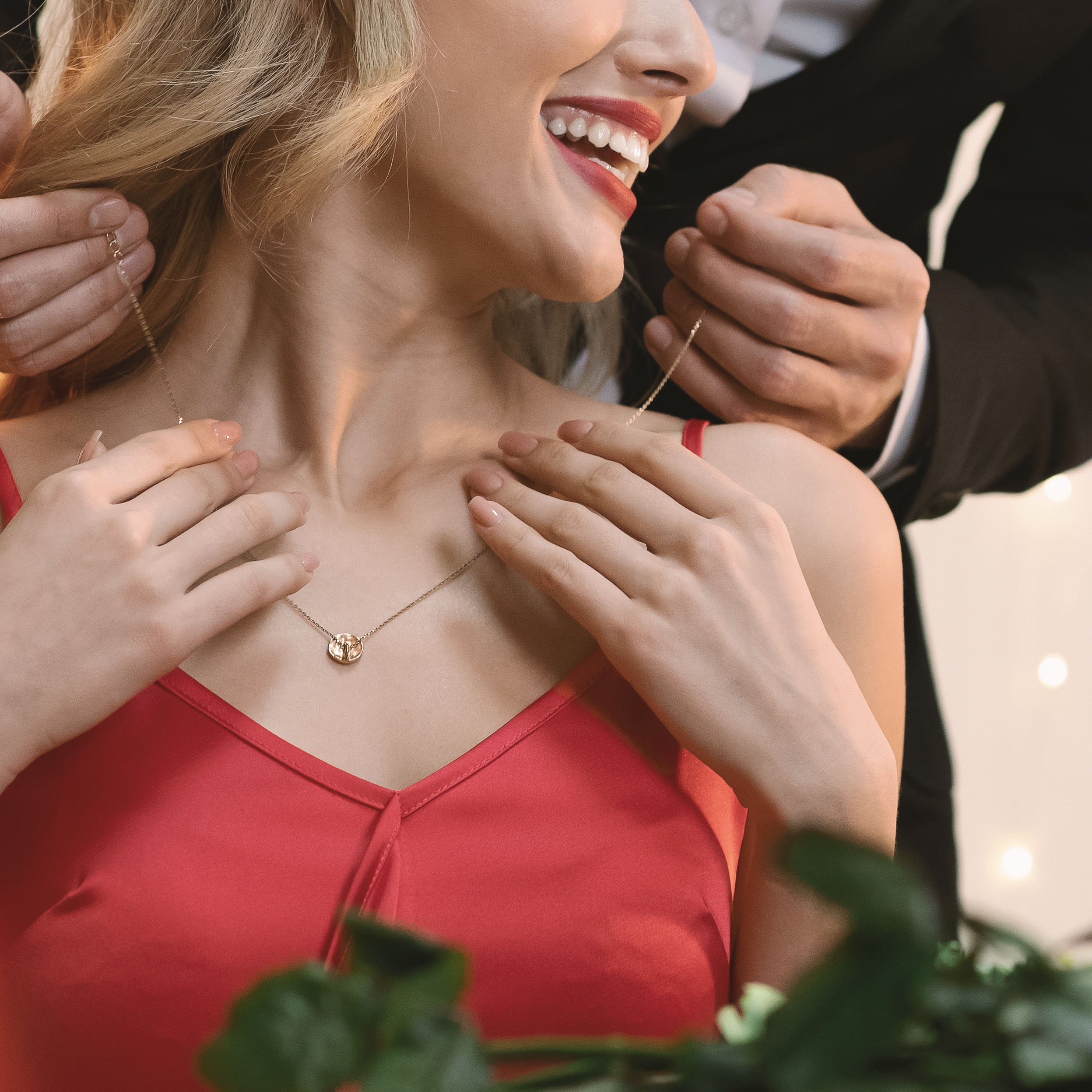 Luxury Gift. Happy Woman Receiving Golden Pendant Necklace on anniversary day