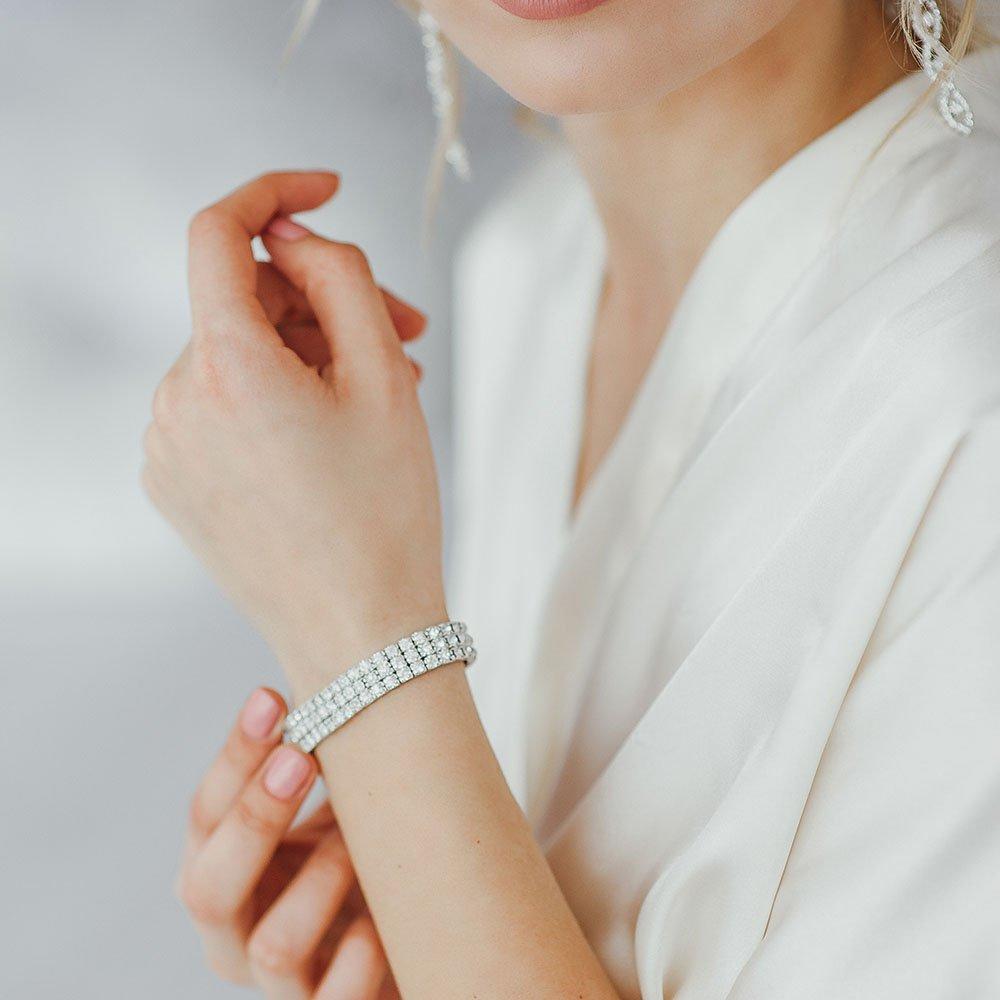 woman wears a bracelet on her hand